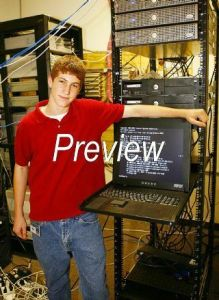 Michael Altfield stands next to a server rack