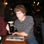 Michael Altfield toasts a Guiness, the first beer he ever ordered.