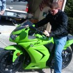Michael Altfield straddles his Kawasaki Ninja 250 while parked