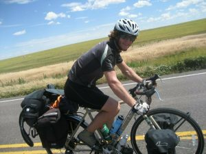 Michael Altfield rides a fully-loaded touring bicycle in the Colorado Eastern Plains