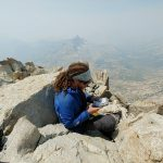 Michael Altfield adds his name to the summit log atop Matterhorn in California